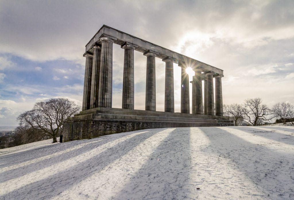 calton hill monument in the edinburgh snow
